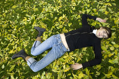 Young woman lying  in autumn park Royalty Free Stock Image