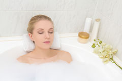 Young woman lying in bath with foam Royalty Free Stock Photography