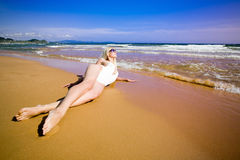 Young woman lying on a beach Royalty Free Stock Image