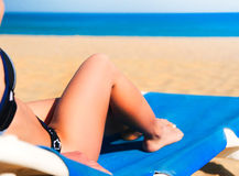 Young woman lying on a beach lounger Royalty Free Stock Photo
