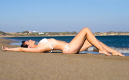 Young woman lying on beach Royalty Free Stock Image