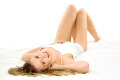 Young woman lying on bed Royalty Free Stock Images