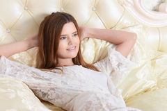 Young woman lying on bed Royalty Free Stock Image
