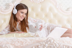 Young woman lying on  bed Royalty Free Stock Photography