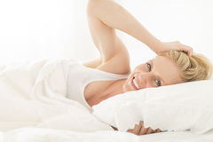 Young Woman Lying On Bed In House Stock Images
