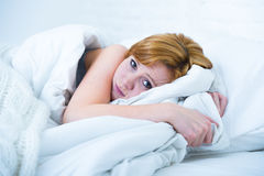 Young woman  lying in bed sick unable to sleep suffering depression and nightmares insomnia sleeping disorder Royalty Free Stock Photos