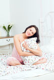 Young woman lying in bed Royalty Free Stock Images