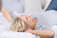Young Woman Lying On Bed Stock Photos