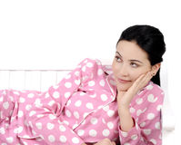 Young woman lying in bedroom smiling Royalty Free Stock Photography