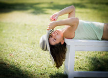 Young woman lying on bench in park Royalty Free Stock Image