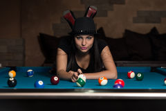Young Woman Lying On The Billiard Table Stock Photos