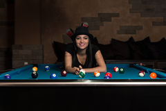 Young Woman Lying On The Billiard Table Royalty Free Stock Photo