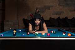 Young Woman Lying On The Billiard Table Stock Images