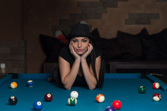 Young Woman Lying On The Billiard Table Royalty Free Stock Photography