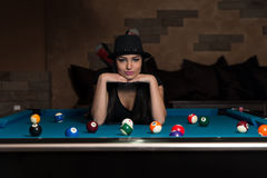 Young Woman Lying On The Billiard Table Stock Image