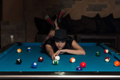 Young Woman Lying On The Billiard Table Royalty Free Stock Images