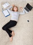 Young woman lying on carpet Royalty Free Stock Image