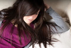Young woman lying on couch Royalty Free Stock Photography