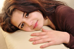 Young woman is lying on a couch Stock Photography