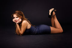 Young woman lying down Royalty Free Stock Photography