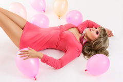 Young woman lying down with air Royalty Free Stock Photos