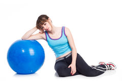 Young woman  lying down on an exercise ball Royalty Free Stock Images