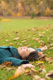 Young woman lying down Royalty Free Stock Image
