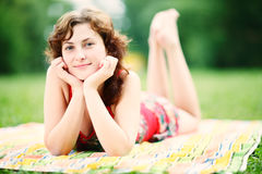Young woman lying down in park enjoying the summer Stock Image