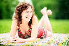 Young woman lying down in park enjoying the summer Royalty Free Stock Image