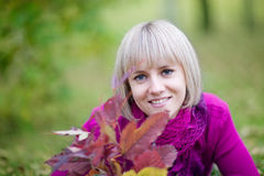 Young woman lying on fall leaves Stock Image