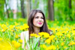 Young woman is lying on field Royalty Free Stock Photo