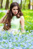 Young woman is lying on field Royalty Free Stock Photography