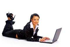 Young woman is lying on the floor. And working on a laptop stock photography