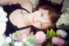 Young woman lying on a floor Royalty Free Stock Photography
