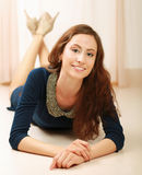 Young woman lying on the floor Royalty Free Stock Photography