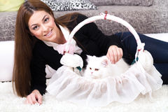 Young woman lying on the floor at home with Persian cat Stock Photos