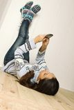 Young woman lying on the floor of the house Stock Images
