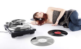 Young Woman Lying on the Floor Listening Music Stock Images