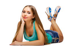 Young woman lying on floor Stock Images