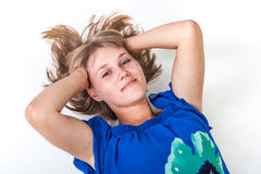 Young woman lying on the floor Stock Photos