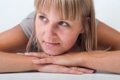 Young woman lying on the floor Stock Photo