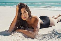 Woman lying on white sand Royalty Free Stock Photo