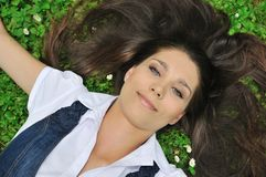 Young woman lying in grass Royalty Free Stock Image