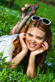 Young woman lying on grass Stock Photos