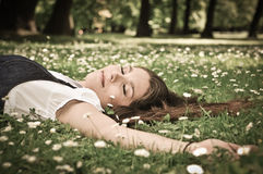 Young woman lying in grass Royalty Free Stock Photos