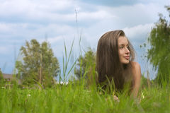 Young woman lying in grass Stock Image