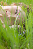 Young woman lying in grass Stock Photo