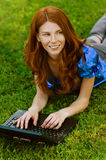 Young woman lying on grass Royalty Free Stock Photography