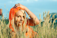 Young woman is lying on a grass. Stock Image