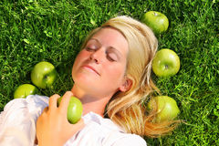Young woman lying in the grass Stock Image